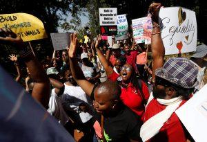 Womens-March-Nairobi-Kenya-012117-by-Thomas-Mukoya-Reuters-web-300x205, Women march against Washington, World News & Views