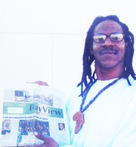 Anthony-Robinson-Jr.-with-Bay-View-paper-0115-web-cropped-279x300, Trump declares war on the media: Build the Bay View to fight back, National News & Views