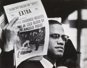 Malcolm-X-w-newspaper-1962-63-'If-youre-not-ready-to-die-for-it-take-the-word-freedom-out-of-your-vocabulary'-by-Gordon-Parks-web-300x235, Black newspapers, now more than ever, must boldly tell the truth, National News & Views