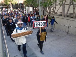 Martin-Luther-King-Day-Jahahara-marching-Reparations-Freedom-011617-by-Adilifu-Fundi-web-300x225, Baron Davis and SF King Day address next four chilling years, but ex-NBA star misses room's 'huge elephant', Local News & Views