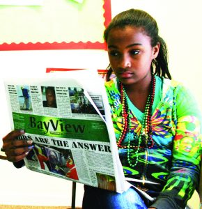 Oakland-Freedom-School-Ida-B.-Wells-class-Olaniyah-Eaglin-reads-SFBV-their-primary-textbook-0810-by-Reginald-James-TheBlackHour.com_-290x300, Trump declares war on the media: Build the Bay View to fight back, National News & Views