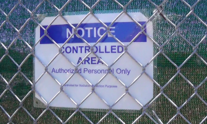 Sign-on-Bigelow-Ct-Treasure-Island-fence-Notice-Controlled-Area-Authorized-Personnel-Only-Controlled-for-Radiation-Protection-Purposes-300x180, I am Felita Sample, a Black female whistleblower. LaKrista Jackson is my daughter., Local News & Views