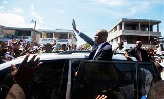 Aristide-greets-supporters-in-Port-au-Prince-just-prior-to-police-attack-032017, Haiti Action Committee denounces the attempted assassination of former President Jean-Bertrand Aristide, World News & Views