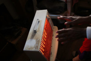 Old-Black-hands-over-old-heater-300x200, NAACP says electricity is a basic human right, demands end to power shutoffs, National News & Views