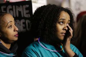 Somalis-Megitu-Argo-daughter-Ebany-Turn-protest-deportation-travel-ban-Seattle-012917-by-Jason-Redmond-AFP-300x200, BAJI: Black activists call for halt to deportation of 50,000 Haitians and 4,000 Somalis, World News & Views