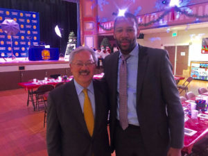 Ed-Lee-Warriors-Public-Affairs-Director-Theodore-Ellington-welcome-200-kids-Season-of-Giving-Bayview-Opera-House-121616-by-Meaghan-Mitchell-Hoodline-300x225, The story of SF Mayor Hood Robin' and his Merrie Men, Local News & Views