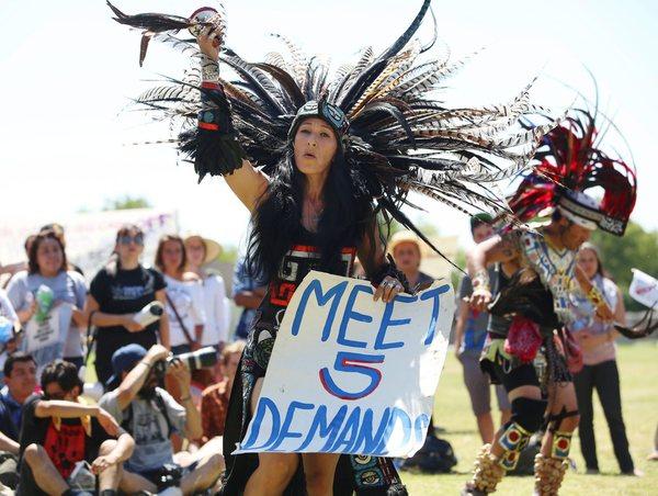 Hunger-Strike-Rally-Corcoran-Yolanda-Santoya-of-LAs-La-Cuauhtemoc-dancers-Meet-5-demands-071313-by-Gary-Kazanjian-EPA, Folsom hunger strikers issue demands and grievances, Behind Enemy Lines