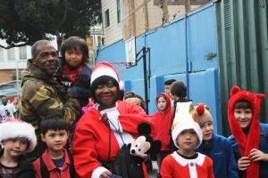 Kilo-G-Perry-w-Black-Ms-Santa-school-children-121815-300x200, Tribute to my pops, Kilo G Perry, Local News & Views