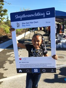 Lil-Black-girl-promotes-mothers-business-She-Got-Her-Own-Clothing-vendor-at-TownBiz-I-Kaiser-Conv-Ctr-1216-web-225x300, TownBiz II, a launching pad for Black vendors, coming June 4 to Oakland's Splash Pad Park, Local News & Views