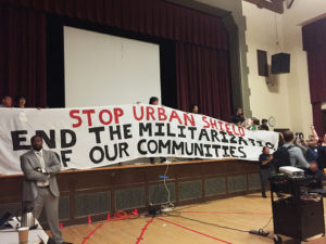 Berkeley-Urban-Shield-Council-vote-banner-unfurled-protesters-take-stage-by-Ashley-Wong-East-Bay-Express-300x225, The federalization of local police: Why the Urban Shield vote failed, Local News & Views