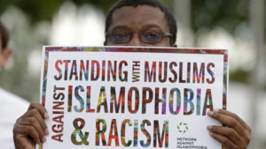 Standing-with-Muslims-against-Islamophobia-racism-Black-man-holding-sign-0117-300x169, Muslims at Texas' Clements Unit are being starved during Ramadan: 'Don't like it? Become a Christian', Behind Enemy Lines