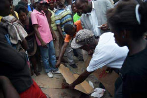 Witnesses-cover-blood-of-book-vendor-murdered-by-police-Petionville-Haiti-071317-by-AFP-300x200, Haiti, stop the repression! No impunity! NO NEW ARMY!, World News & Views