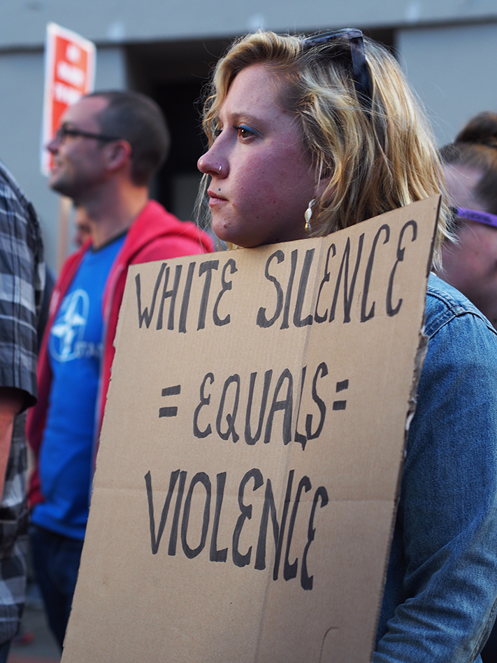 Charlottesville-solidarity-march-white-woman-White-silence-equals-violence-Oakland-081217-by-Nik-Wojcik-web, Charlottesville solidarity: Undeterred protesters march in Oakland to tune of Strange Fruit, Local News & Views