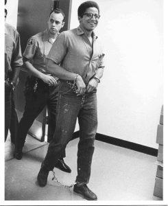 George-Jackson-walking-shackled-web-245x300, I AM WE!, Behind Enemy Lines