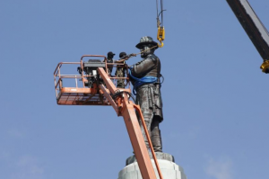 Robert-E.-Lee-statue-attached-to-crane-to-lift-it-off-pedestal-New-Orleans-last-of-4-Confederate-statues-removed-051917-by-Jonathan-Bachman-300x199, Fast and fatal: Car plows into crowd protesting Unite the Right rally to save Robert E. Lee statue in Charlottesville park, National News & Views