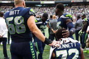 Seattle-Seahawks-Jason-Britt-Frank-Clark-support-seated-Michael-Bennett-081817-by-Genna-Martin-Seattle-PI-300x200, NFL 'Blackout' for Kaepernick, National News & Views