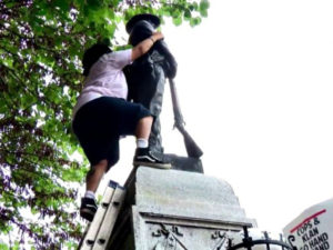 Takiyah-Thompson-climbs-ladder-to-pull-down-Confederate-statue-Durham-NC-081517-by-CBS-News-300x225, As a nation grapples with white supremacy, the Millions for Prisoners March comes at the perfect time, National News & Views