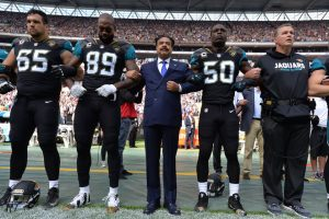 Jacksonville-Jaguars-owner-Shad-Khan-locks-arms-with-protesting-team-members-092417-300x200, For the NFL, it was 'Choose your side Sunday', National News & Views