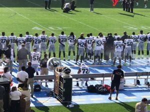 Michael-Bennett-72-sits-for-natl-anthem-Seahawks-season-opener-081317-by-Dennis-Bernstein-300x225, Mercury in retrograde: Las Vegas cops assault NFL star Michael Bennett, National News & Views