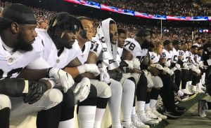 Oakland-Raiders-lock-arms-kneel-092417-300x183, For the NFL, it was 'Choose your side Sunday', National News & Views