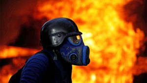 Venezuela-guarimba-in-gas-mask-fire-0817-by-Carlos-Garcia-Rawlins-Reuters-300x169, What's REALLY happening in #Venezuela – from someone who knows, World News & Views
