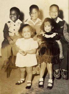 Watani-Stiner-age-6-siblings-Gregory-Watani-Larry-Ali-George-front-Tamu-Janis-Phyllis-222x300, Watani Stiner: Tending to historical wounds, Behind Enemy Lines
