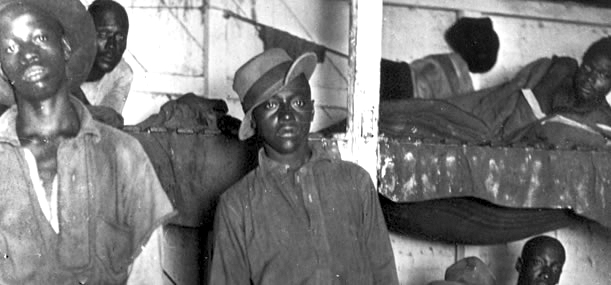 Youth-in-Georgia-forced-labor-camp-c.-1932-by-John-Spivak-bunks, US prisons practice the same slavery and racism celebrated by Confederate monuments, Behind Enemy Lines