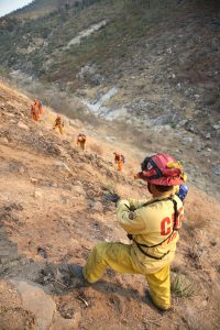 Fireman-supervises-women-prisoner-firefighters-Witch-Fire-Santa-Ysabel-CA-102507-by-Adam-Tanner-Reuters-web-200x300, Incarcerated women risk their lives fighting California fires – part of a long history of prison labor, Behind Enemy Lines