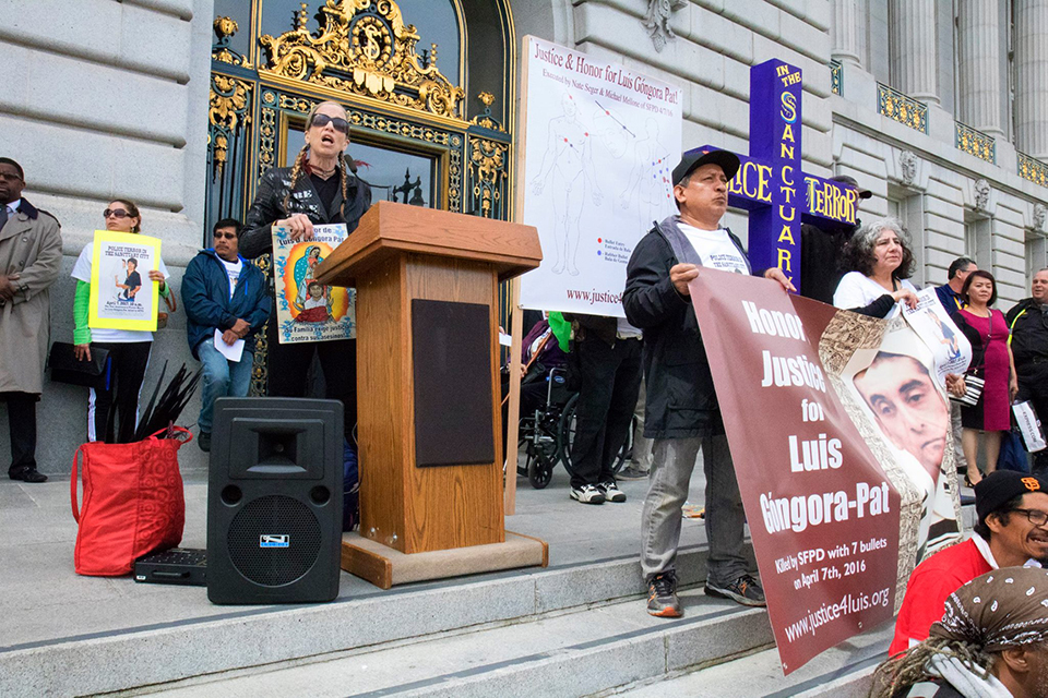 Luis-Gongora-Pat-1st-anniversary-rally-Tiny-speaks-City-Hall-040717-by-Peter-Menchini, Witnesses to a police murder are mysteriously dying, Local News & Views