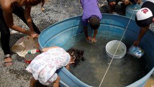 Puerto-Rican-children-drink-dirty-water-101417-by-Reuters-300x170, Caribbean power bloc forms to challenge Trump's war mongering and climate change denial, World News & Views