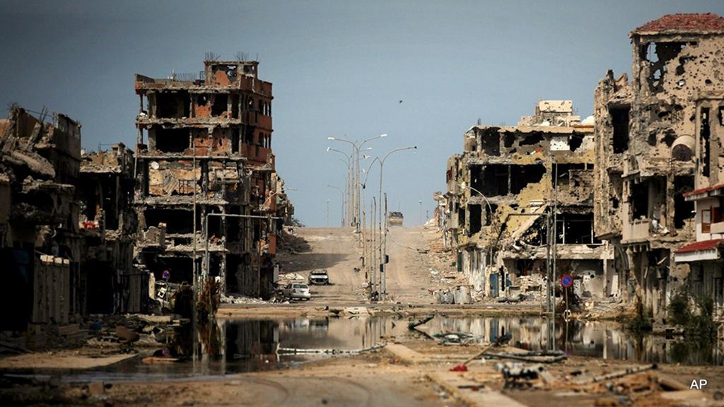 Sirte-Libya-after-ferocious-battle-1011-by-AP-web, Remembering Muammar Qaddafi and the great Libyan Jamahiriya, World News & Views