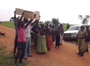 Ugandans-protesting-land-grabbing-women-remove-shirts-300x220, Solidarity Uganda: Rural Ugandans resist land grabbing and US-backed dictatorship, World News & Views