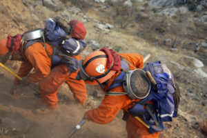 Women-prisoner-firefighters-fight-Witch-Fire-Santa-Ysabel-CA-102507-by-Adam-Tanner-Reuters-web-300x200, Incarcerated women risk their lives fighting California fires – part of a long history of prison labor, Behind Enemy Lines