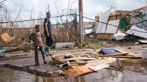 After-Hurricane-Irma-man-and-boy-survey-damage-in-Marigot-St.-Martin-090717-by-CNN-300x169, The Caribbean is being killed: Time to fight back, World News & Views