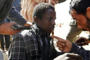 Anti-Qaddafi-forces-threaten-young-Black-African-Libya-between-towns-Brega-Ras-Lanuf-030311-by-Goran-Tomasevic-Reuters-300x201, Deceptive intelligence: CNN breaks story on slave trade in Libya, World News & Views