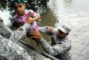 Black-soldiers-save-child-from-floodwaters-Hurricane-Katrina-0905-300x202, Can the military do some good?, Culture Currents