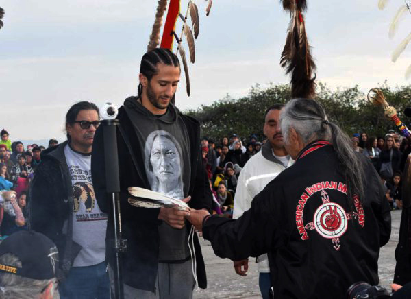 Colin-Kaepernick-honored-by-AIM-spiritual-leader-Fred-Short-w-eagle-feathers-speaks-Indigenous-Peoples-Sunrise-Gathering-Alcatraz-112317-by-Christopher-Burquez-Native-News-Online-1, Expressing gratitude, Culture Currents