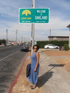 Playwright-actor-Margo-Hall-at-newly-installed-'Love-Life-Welcome-to-Oakland'-sign-108th-Bancroft-1017-by-Jahahara-web-225x300, Can the military do some good?, Culture Currents