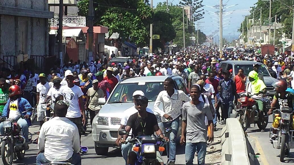 Port-au-Prince-Haiti-mass-protest-march-against-remilitarization, Police massacre in Gran Ravin, protesting students in Cap Haitien beaten by police, World News & Views