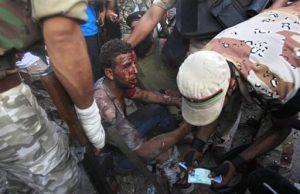 Pro-Qaddafi-Black-man-captured-by-rebels-in-Abu-Salim-district-Tripoli-Libya-082511-by-Sergey-Ponomarev-AP-300x194, Deceptive intelligence: CNN breaks story on slave trade in Libya, World News & Views