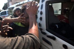 Pro-Qaddafi-Black-man-manhandled-by-rebels-in-Sirte-Libya-101211-by-Aris-Messinis-AFP-300x200, Deceptive intelligence: CNN breaks story on slave trade in Libya, World News & Views