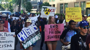 Protesters-block-traffic-during-march-against-toxic-prisons-by-Carimah-Townes-300x169, Eastham water supply shut completely OFF, stench of human waste pervades old, decaying prison, Behind Enemy Lines