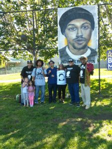 Wealth-Disparities-Gwen-Woods-activists-Mario-Woods-banner-Mario-Woods-Remembrance-Day-Marios-b'day-072216-225x300, Mario Woods and the movement for justice in our second year, Local News & Views