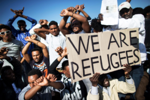 We-are-refugees-Africans-in-Israel-protest-Natanyahus-deportation-excuse-1117-300x201, Trafficking in desperate Black African migrants, from Israel to Rwanda to Libya, World News & Views