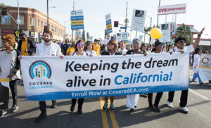 Covered-Cali-Charles-R.-Drew-University-of-Medicine-and-Science-Assemblywoman-Autumn-Burke-100-contingent-in-MLK-Kingdom-Day-Parade-in-LA-011518-300x182, Covered California predicts dramatic healthcare premium increases without federal action, National News & Views
