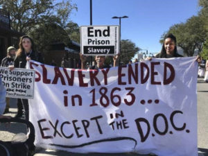 End-Prison-Slavery-Slavery-Ended-in-1863-...-except-in-the-D.O.C.-strike-Lake-Butler-Work-Camp-Gainesville-FL-011518-by-J.-Wright-Workers-World-web-300x225, Florida prisoners launch strike against slave labor, Behind Enemy Lines