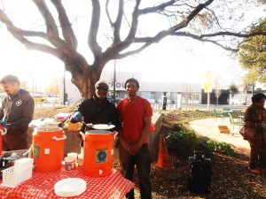 Helping-feed-the-people-with-Food-of-God-in-Oakland-near-Greyhound-Bus-Stn-web-300x225, Gentrification = genocide!, Culture Currents
