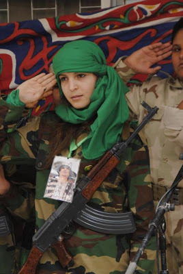 Libyan-girl-w-assault-rifle-salutes, Statement of the Libyan National Popular Movement on the Seventh Anniversary of the February Conspiracy, World News & Views