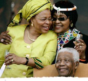 Graca-Machel-Winnie-Mandela-Nelson-Mandela-at-ANCs-Madiba-90th-Birthday-celebration-at-Loftus-Versfeld-Stadium-Tshwane-South-Africa-080208-by-Michelly-Rall-WireImage-300x276, Winnie Madikizela Mandela (1936-2018), World News & Views