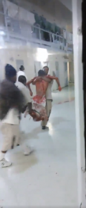 Lee-CI-stabbed-prisoner-carried-0415-1618-by-prisoner-cell-phone-video-125x300, South Carolina freedom fighters call for National Prisoners Strike Aug. 21-Sept. 9, 2018, Behind Enemy Lines
